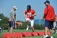 Ole Miss' Patrick Junen (77) goes through a drill as Ole Miss began football practice in Oxford, Miss. on Saturday, August 4, 2012.