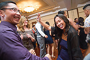 Marissa and Zach Canez celebrate their wedding with family and friends at Saint John the Baptist Church in Milpitas, California, on October 25, 2014. (Stan Olszewski/SOSKIphoto)