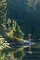 Young man hiking in Mount Rainier National Park, WA<br />