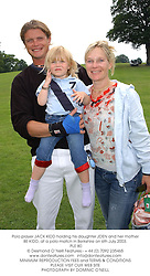 Polo player JACK KIDD holding his daughter JDEN and her mother BE KIDD, at a polo match in Berkshire on 6th July 2003.<br /> PLE 80