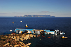 "Rubber booms being placed around the The Wrecked Cruise Ship ""Costa Concordia"" in Giglio, Italy, Photo By Nick Cornish/ I-Images"