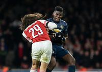 Football - 2018 / 2019 FA Cup - Fourth Round: Arsenal vs. Manchester United <br /> <br /> Matteo Guendouzi (Arsenal FC) bodychecks Paul Pogba (Manchester United) at The Emirates Stadium.<br /> <br /> COLORSPORT/DANIEL BEARHAM