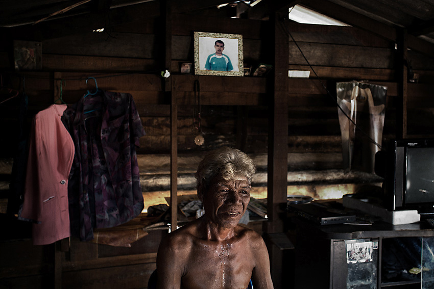 RANONG PROVINCE,SOUTHERN THAILAND,AUGUST 2012: Sitdit, a Moken elder, in his house in Koh ao Vilage, Ranong province, southern Thailand. His son, hired by Thai fishermen, died from decompression sickness while collecting sea cucumbers at the bottom of the ocean.<br /> The Moken are a nomadic sea people who live in and around southern Thailand, traditionally feeding of the fruits of the sea for eight months a year. But the 2004 Indian Ocean tsunami destroyed many livelihoods, and the Moken were forced onto the land.<br /> Brought to the world's attention by the natural disaster, the seafaring tribe is struggling to reconcile tradition and modernity, leaving behind their &quot;sea gypsy&quot; life for a modern existence