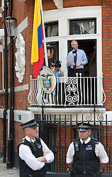 © Licensed to London News Pictures. 19/08/2012. Wikileaks founder Julian Assange speaking from a balcony at The Ecuador Embassy in London on August 19/08/2012. Assange, who faces arrest by British police if he leaves the building, took refuge in the embassy on June 19 to evade extradition to Sweden where he is wanted for questioning over alleged sexual misconduct. Photo credit : Ben Cawthra/LNP