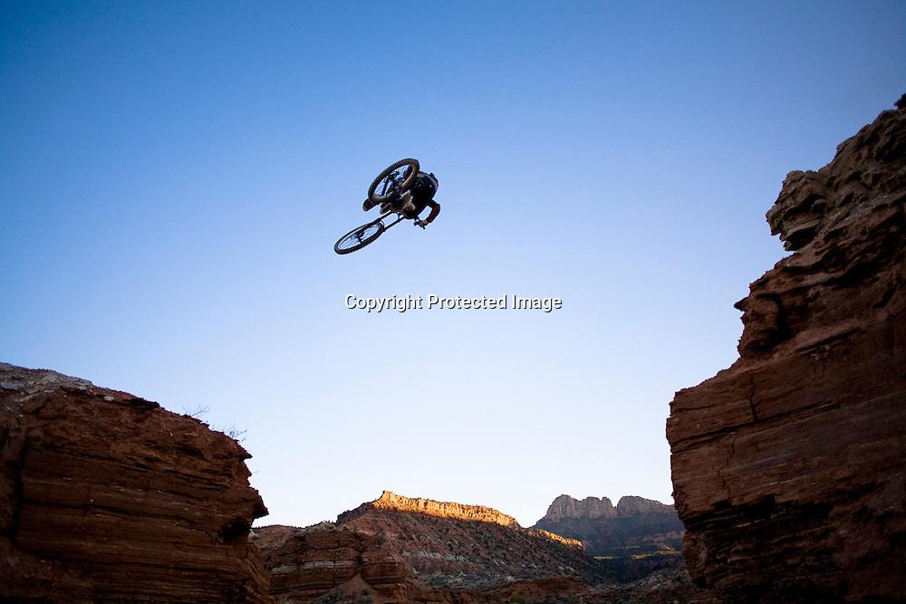 Aaron Mendoza jumps across the Grafton Mesa road gap near Springdale, Utah