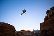 Aaron Mendoza jumps across the Grafton Mesa road gap near Springdale, Utah