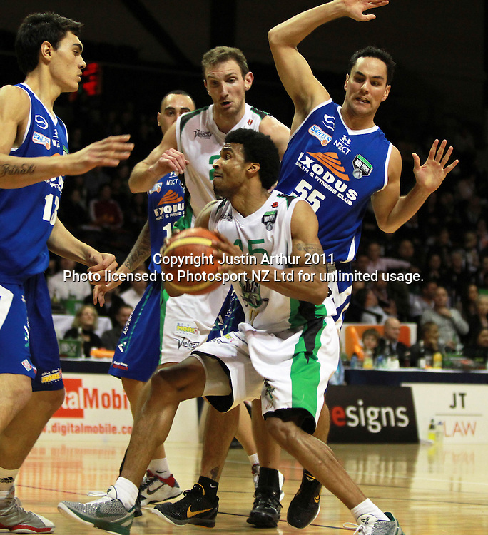 Jets Darryl Hudson on the attack as the Saints look to defend. NBL- Wellington Saints v Manawatu Jets at TSB Bank Arena Wellington, New Zealand on Friday 24 June 2011. Photo: Justin Arthur/ photosport.co.nz