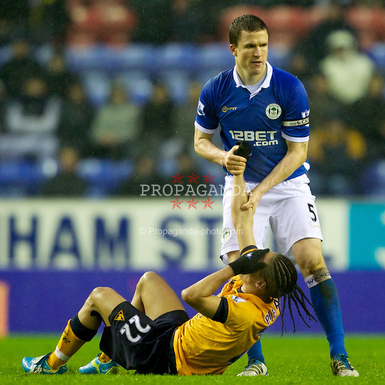WIGAN, ENGLAND - Saturday, February 4, 2012: Everton's Steven Pienaar in action against Wigan Athletic's captain Gary Caldwell during the Premiership match at the JJB Stadium. (Pic by Vegard Grott/Propaganda)