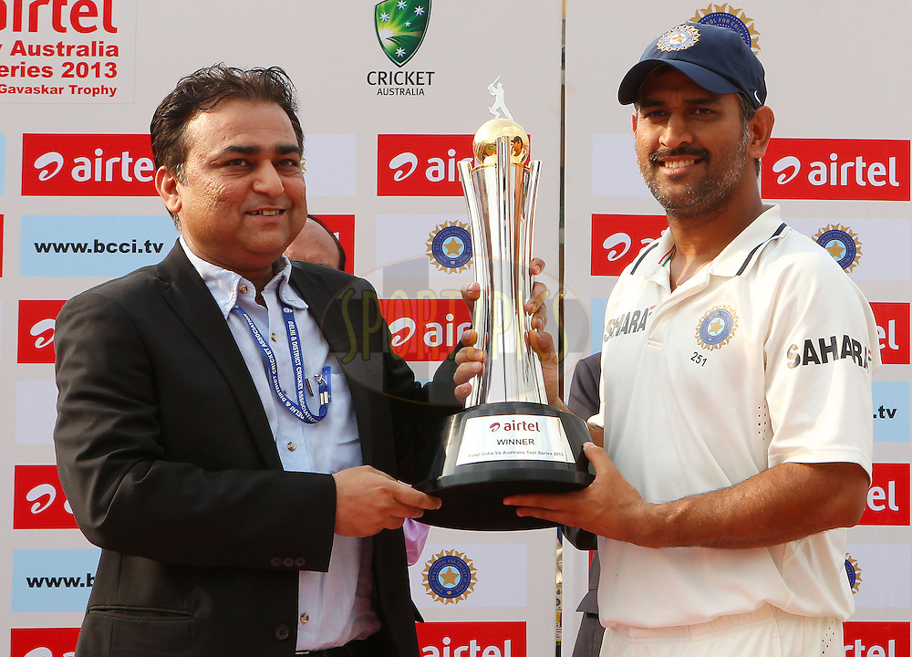 MS Dhoni of India receives the series trophy during day 3 of the 4th Test Match between India and Australia held at the Feroz Shah Kotla stadium in Delhi on the 24th March 2013..Photo by Ron Gaunt/BCCI/SPORTZPICS ..Use of this image is subject to the terms and conditions as outlined by the BCCI. These terms can be found by following this link:..http://www.sportzpics.co.za/image/I0000SoRagM2cIEc