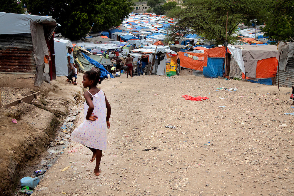 A girl in the makeshift refugee camp, JP HRO, run by the movie actor Sean Penn in Port-au-Prince, Haiti on July 16, 2010.<br /> The camp is estimated to have over 55,000 refugees.<br /> Six month after a catastrophic earthquake measuring 7.3 on the Richter scale hit Haiti on January 13, 2010, killing an estimated 230,000 people, injuring an estimated 300,000 and making homeless an estimated 1,000,000.