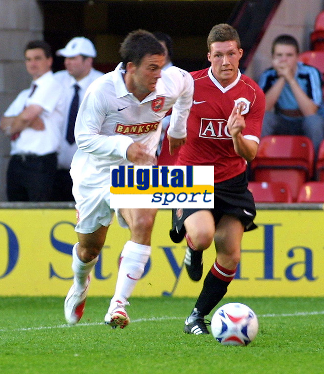 Photo: Dave Linney.<br />Walsall FC v Manchester United XI. Pre Season Friendly. 18/07/2006Walsall's .Daniel Fox(L)  leads the chase for the ball , with  Phil Marsh left standing
