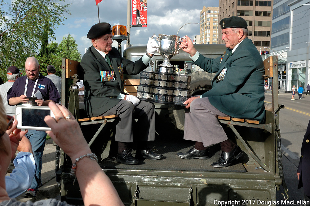 CANADA, Windsor. May, 2017. The Memorial Cup trophy arrives by ship to Windsor to start the Mastercard Memorial Cup Hockey Tournament. The trophy arrives at Dieppe Park to indigenous and military ceremonies. Later it advances its way down Ouellette Avenue to City Hall Cenotaph to a military remembrance ceremony. NOTE: Agefotostock exclusive license, G99-2888705, to license go to http://www.agefotostock.com/age/en/Stock-Images/Rights-Managed/G99-2888705