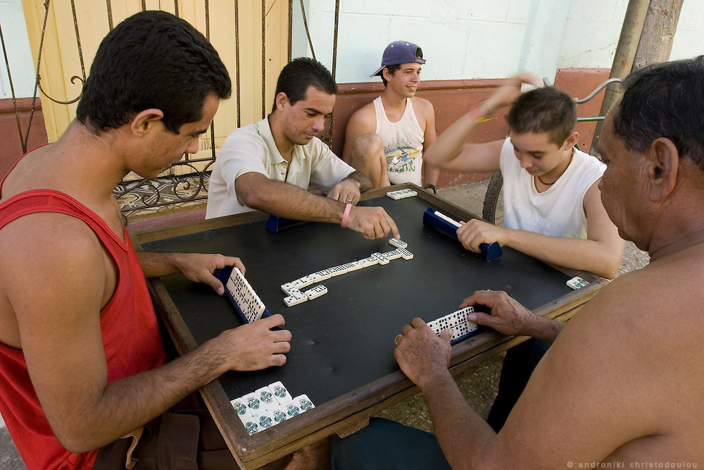 Playing domino on a street in Trinidad which is a popular tourist destination of Cienfuefos province - CUBA