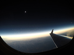 A total solar eclipse is seen on Monday, August 21, 2017 from onboard a NASA Armstrong Flight Research Center's Gulfstream III 25,000 feet above the Oregon coast. A total solar eclipse swept across a narrow portion of the contiguous United States from Lincoln Beach, Oregon to Charleston, South Carolina. Photo Credit: (NASA/Carla Thomas)