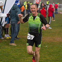 John Cahill, from West Clare Triatlon Club crossing the finishing line at the National Duathlon Championship in Lees Road, Ennis