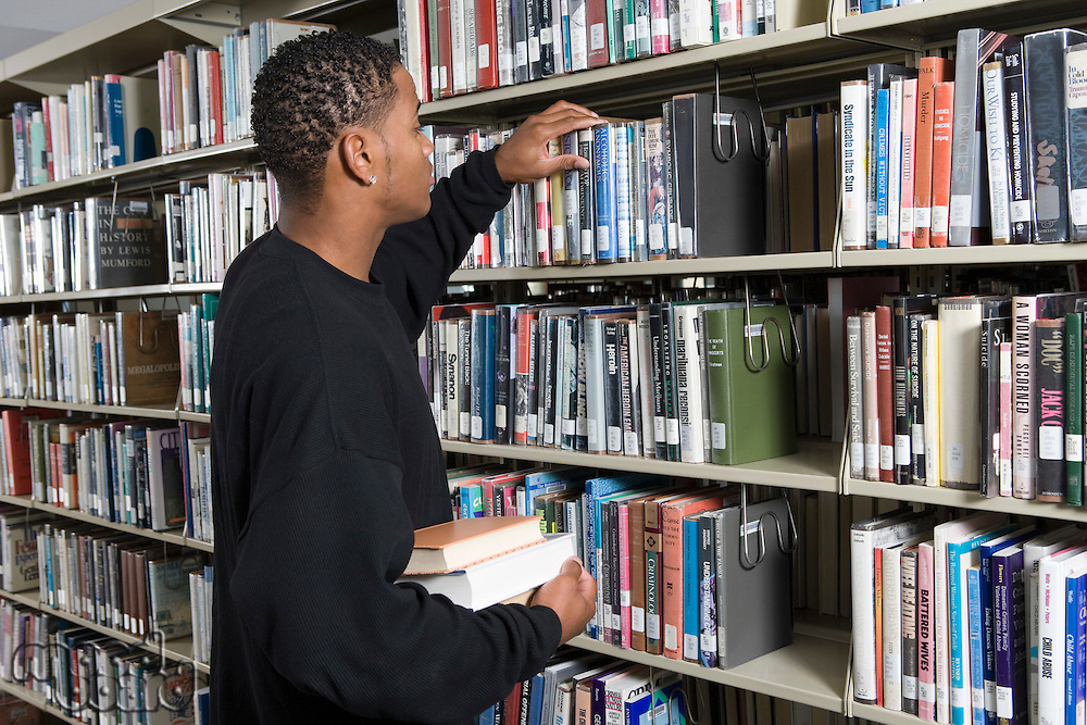 Male University student in library