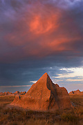The afterglow after sunset brings a glow to the rich colored sandstone of the Badlands National Park in South Dakota