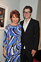 KATHY LETTE and her son JULIUS ROBERTSON at a private view of Bill Wyman - Reworked held at the Rook & Raven Gallery, 7 Rathbone Place, London W1 on 26th February 2013.