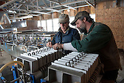 Todd Scelza and Ozzie Henchel prepare a maple filter at Shadow Lake Maples in Barton, Vermont.