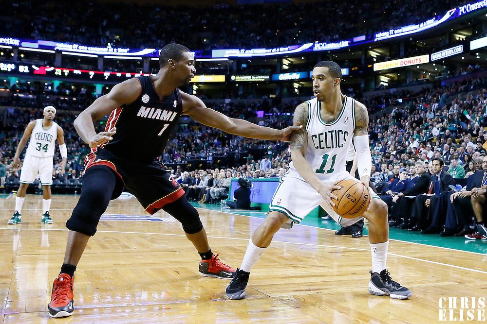 27 January 2013: Miami Heat center Chris Bosh (1) defends on Boston Celtics shooting guard Courtney Lee (11) during the Boston Celtics 100-98  2OT victory over the Miami Heat at the TD Garden, Boston, Massachusetts, USA.