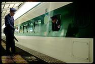 Stationmaster points out where engineer must stop bullet train at Utsunomiya station platform. Japan