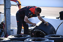 April 6, 2018 - Phoenix, AZ, U.S. - PHOENIX, AZ - APRIL 07: tCrew member prepares Firestone tires for race in the Verizon IndyCar Series Desert Diamond West Valley Casino Phoenix Grand Prix on April 7, 2018, at ISM Raceway in Phoenix, AZ. (Photo by Grant Exline/Icon Sportswire) (Credit Image: © Grant Exline/Icon SMI via ZUMA Press)