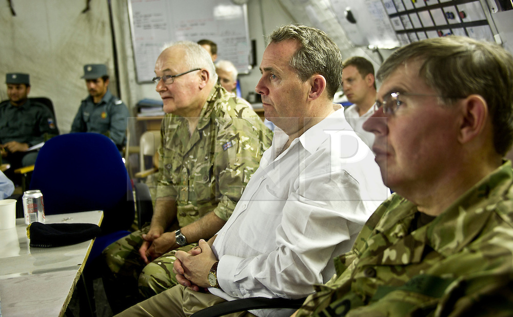 © Licensed to London News Pictures. 17/06/11. Helmand, Afghanistan. Secretary of State for Defence Dr Liam Fox (White Shirt) visiting 3 Commando Brigade in Helmand Province (15 Jun 11).  Dr Fox today (23/06/2011) revealed that the cost of UK military operations in Libya as part of the UN resolution currently stands at £260m so far. Photo credit to read Alison Baskerville/LNP