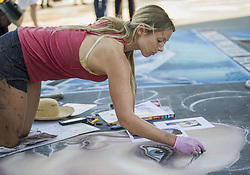 May 28, 2017 - Santa Barbara, California, USA - Artists of all ages create vibrant and colorful pastel chalk creations on the plaza at Mission Santa Barbara at the I Madonnari Street Painting Festival. The festival over the Memorial Day weekend benefits the Children's Creative Project, a nonprofit arts education program of the Santa Barbara County Education Office. (Credit Image: © PJ Heller via ZUMA Wire)