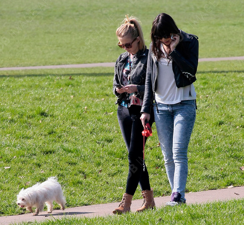 15.MARCH.2012. LONDON<br /> <br /> DAISY LOWE WALKING HER DOG WITH A FRIEND IN PRIMROSE HILL<br /> <br /> BYLINE: EDBIMAGEARCHIVE.COM<br /> <br /> *THIS IMAGE IS STRICTLY FOR UK NEWSPAPERS AND MAGAZINES ONLY*<br /> *FOR WORLD WIDE SALES AND WEB USE PLEASE CONTACT EDBIMAGEARCHIVE - 0208 954 5968*