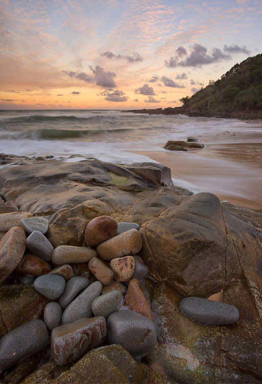 As the sky was beginning to light up from the reflected sunset, I looked for a new composition  that I hadn't shot before. A cluster of rounded rocks took my eye for ideal foreground.