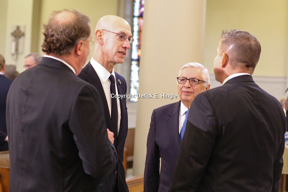 NBA Commissioner Adam Silver and former Commissioner David Stern talk with New Orleans Saints President Dennis Lauscha (left) and head coach Sean Payton (right) at the funeral service for NFL New Orleans Saints owner and NBA New Orleans Pelicans owner Tom Benson in New Orleans, Friday, March 23, 2018. Benson died last Thursday at the age of 90. (AP Photo/Derick Hingle)