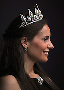 © licensed to London News Pictures. LONDON, UK.  06/06/11. A Christies employee models the Rosebery pearl & diamond tiara, bracelet and brooch, which is estimated to fetch £1 million to £1.5million in a sale on June 8th.  Photo credit should read Stephen Simpson/LNP
