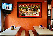 Inside El Comal Restaurant, a Salvadoran family owned business featuring Mexican and Central American cuisine. The restaurant is in the Leamington uptown area, popular with migrant workers after work.
