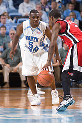 28 December 2006: North Carolina Tarheel guard (5) Ty Lawson defends Rutgers guard (3) Coutney Nelson during a 87-48 Rutgers Scarlet Knights loss to the North Carolina Tarheels, in the Dean Smith Center in Chapel Hill, NC.<br />