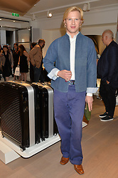 HENRY CONWAY at the launch of the new Rimowa store at 153a New Bond Street, London on 29th June 2016.