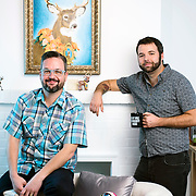 October 6, 2015 - New York, NY : Jeffrey Cranor, left, and Joseph Fink pose for a portrait in Joseph's Brooklyn office on Tuesday afternoon. Fink and Cranor are the creators of the podcast radio show 'Welcome to Night Vale'. In the background are some of the more than 60 paintings/artworks of deer given to Joseph by fans after he mentioned seeing, and regretting having not purchased, a similar painting. CREDIT: Karsten Moran for The New York Times