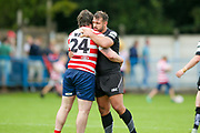 Oldham player Michael Ward is comiserised by Bradford Bulls hooker Scott Moore (34)?after the defeat during the Kingstone Press Championship match between Oldham RLFC and Bradford Bulls at Bower Fold, Oldham, United Kingdom on 13 August 2017. Photo by Simon Davies.