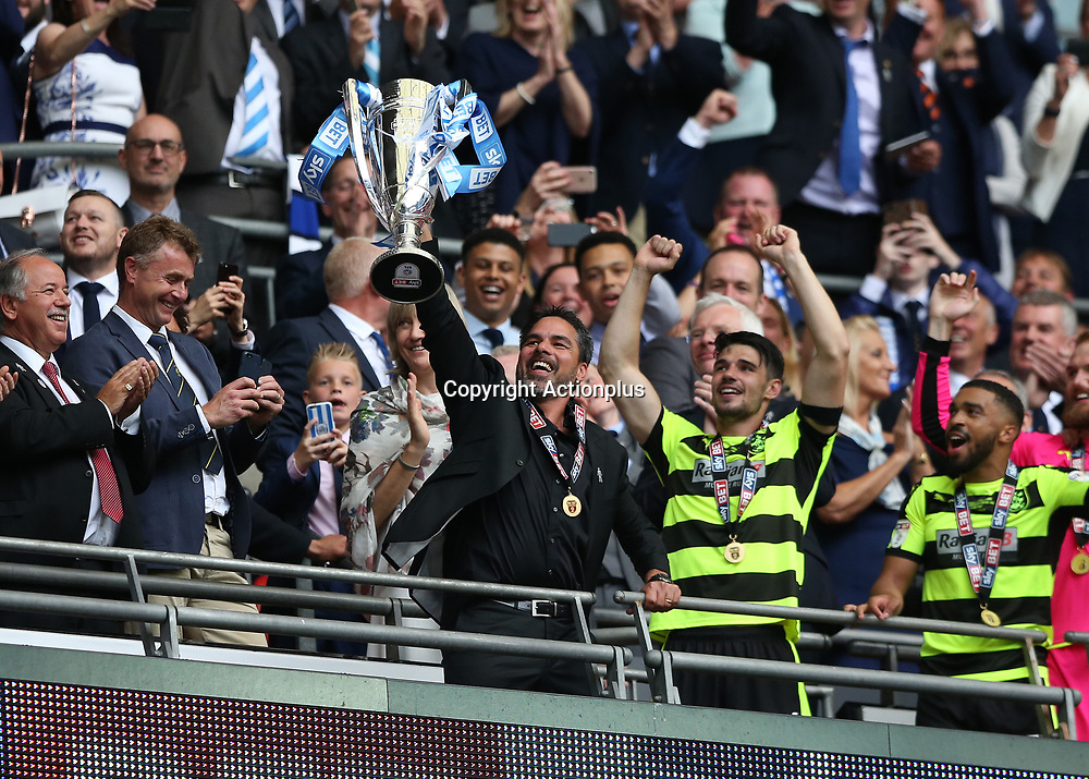 May 29th 2017, Wembley Stadium, London, England; EFL Championship playoff final, Huddersfield Town versus Reading; Huddersfield Town Head Coach David Wagner lifts the EFL Championship playoff final trophy from the top tier with his players