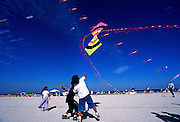 Image of kids flying kites on the white sand beach, South Beach, Miami, Florida, American Southeast