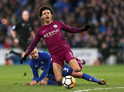 Manchester City's Leroy Sane (front) is tackled by Cardiff City's Joe Bennett