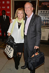 GYLES BRANDRETH and his wife MICHELE at the West End opening night of 'Great Britain' a  play by Richard Bean held at The Theatre Royal, Haymarket, London followed by a post show party at Mint Leaf, Suffolk Place, London on 26th September 2014.