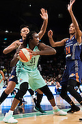 Tina Charles #31 of the New York Liberty drives to the basket against Mistie Bass #8 and DeWanna Bonner #24 of the Phoenix Mercury during the second round of the WNBA Playoffs at Madison Square Garden in New York on September 24, 2016. (Cooper Neill for The New York Times)