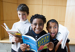 Repro Free: 23/05/2013 Time to Read @ ITB .David Hepes, Elshadai Veloso and Mogamad Shu-Aib Isaacs pupils of Castaheany Educate Together NS are pictured celebrating with a Tea Party, the completion of ITB's (Institute of Technology Blanchardstown) first 'Time to Read' Project. The 24 week programme with volunteer readers from ITB, helped the children develop a love of reading whilst encrouaging them to become independent readers. Pic Andres Poveda..www.itb.ie .For further information please contact Ann-Marie Sheehan, Aspire PR T : 0872985569 E : annmarie@aspire-pr.com.