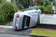 Auckland-Driver trapped in rolled car, Great North Road