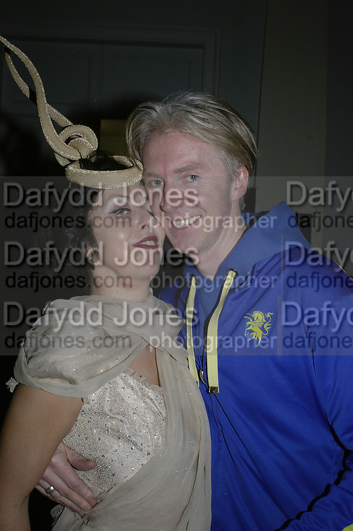 Isabella Blow and Philip Treacy, Andy and Patti Wong's Chinese New Year of the Pig party. Madame Tussauds. ( Dress Burlesque, Debauched or Hollywood Black Tie. ) London. 27 January 2007.  -DO NOT ARCHIVE-© Copyright Photograph by Dafydd Jones. 248 Clapham Rd. London SW9 0PZ. Tel 0207 820 0771. www.dafjones.com.