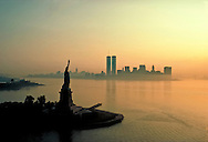 Statue of Liberty and Lower Manhattan at sunrise, New York City, New York aerial, foggy morning