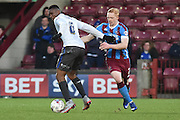 Luke Williams of Scunthorpe United tackles Kelvin Etuhu (6) of Bury during the Sky Bet League 1 match between Scunthorpe United and Bury at Glanford Park, Scunthorpe, England on 19 April 2016. Photo by Ian Lyall.