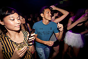 ASIAN CLUBBER DANCING WITH BIG SMILE