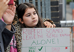 Pictured: Child protester carries placard condemning Riupert Soames, boss of private firm SERCO.<br /> <br /> Protesters gathered outside the main Home Office building in Glasgow to protest at private company SERCO's attempts to evict failed asylum seekers from their homes.<br /> <br /> &copy; Dave Johnston / EEm