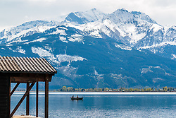 THEMENBILD - Angler in einem Boot am Zeller See dahinter von Schnee bedeckte Berge, aufgenommen am 1. Mai 2017, Zell am See, Österreich // Anglers in a boat at Lake Zell behind snow covered Mountains at Zell am See, Austria on 2017/05/01. EXPA Pictures © 2017, PhotoCredit: EXPA/ JFK